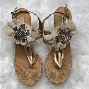 Wedges with decorative flower